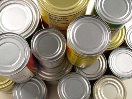 Photo of various canned goods stacked on top of each other.