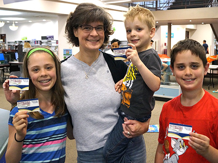 Photo of a family showing their Palatine Library cards