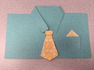 blue shirt with yellow patterned tie greeting card.