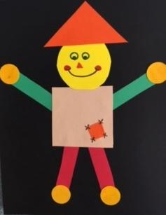 scarecrow built using various geometric shapes and autumn colors